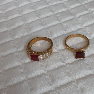 Lot of 2 gold tone rings with red stones